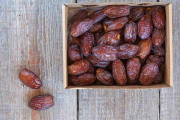 Fresh royal medjool dates in the box. Love for a healthy vegan food concept.