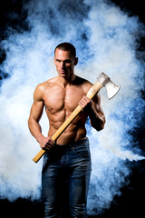 fitness muscular male model with axe