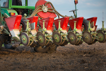 Seeder for sowing attached to tractor on soil