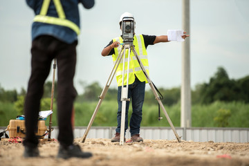 survey engineer in construction site use theodolite mark a concrete pile co ordinate  Fotomurales