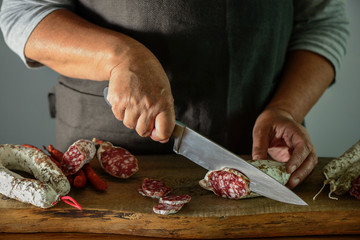 Salami is being cut on a table