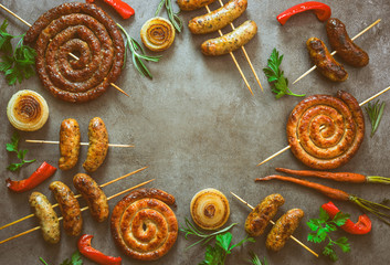 Spicy grilled sausages background