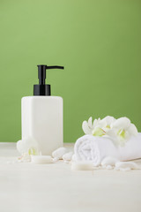 Foto op Canvas Spa SPA Decoration. Spa composition with cosmetic bottle over green.