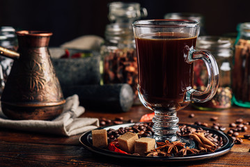 Cezve and Cup of Coffee on Metal Plate with Oriental Spices.