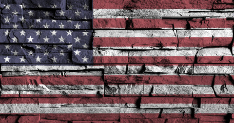 American flag painting on high detail of old brick wall .