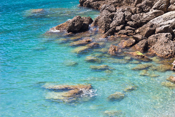 Beautiful natural rocky beach blue sea and sunny day.