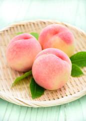 Fresh Ripe Peaches on Japanese Zaru Basket
