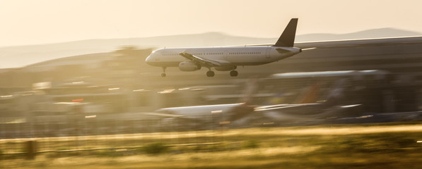 airplane landing on an airport in the evening