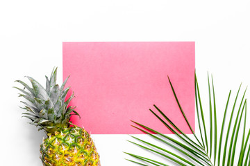 Pineapple and palm branch on white background top view mock up