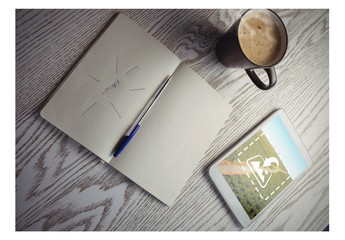 Tablet on Table with Coffee Mug and Notebook Mockup 1