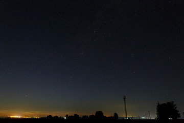 Starry sky above the city outskirts.