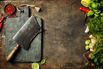 Fototapete - Vintage cutting board,meat cleaver and cooking ingredients