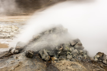 Natural Hot Springs geyser in Iceland with Steam