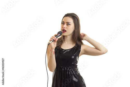 Lovely Young Woman In Black Dress Singing Song With Karaoke Stock