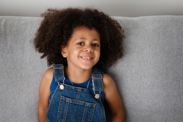 smiling portrait of young girl with afro hair