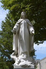 Statue of Saint Therese of Lisieux in Paris, Catholic example of love and simplicity