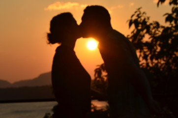 Honeymoon couple kissing at sunset in Sri Lanka
