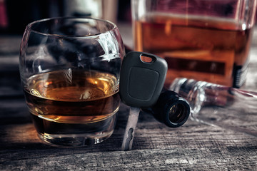 Whiskey in glass and car keys