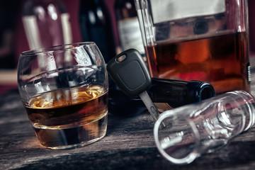 Car key set again glass of brandy