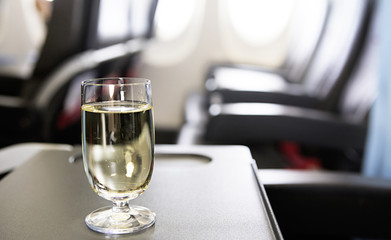 glass of wine in the plane