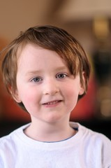 Portrait of a cute little boy smiling Indoors