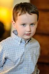 Portrait of a cute little boy inside