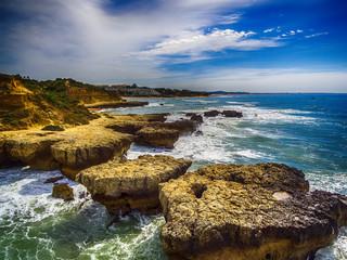 Algarve, Portugal: aerial UAV photo of rocks in the coast of Albufeira at sunrise