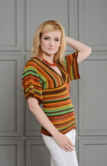 Beautiful woman dressed with 1970s style. Warm colors