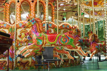 carousel merry-go-round painted horses ride - Stock Photo