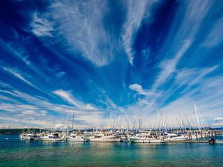 Yachts moored at the marina, sunny day