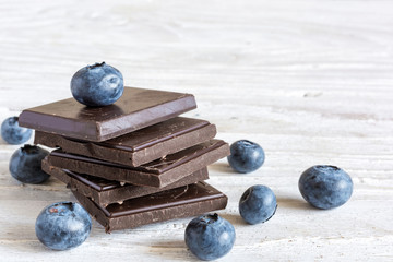 Dark chocolate stack with fresh ripe blueberries