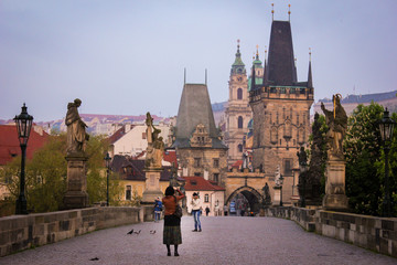 People taking pictures at Prague's Charles bridge