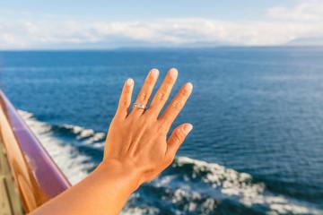Woman showing new wedding ring hand on newlyweds honeymoon cruise travel taking selfie on holidays. Engagement ring and wedding band. Luxury vacations.