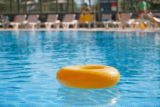 floating ring on blue water swimpool