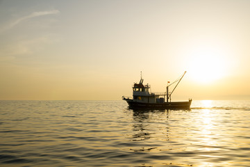 Beautiful Seascape while Sunset with Fishing Boat