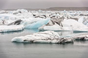 Cracking ice floating on lake
