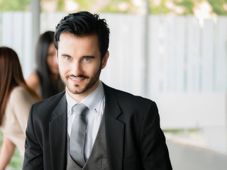Happy businessman looking at the camera,office worker,business decisions in office building