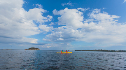 A process of kayaking in the lake skerries, with colorful canoe kayak boat paddling, vibrant summer picture