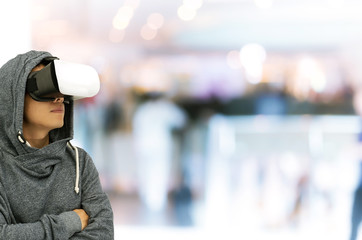isolated man using VR glasses on on shopping mall background