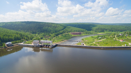 Panorama of spillway on old hydroelectric power station in sunny day aerial view