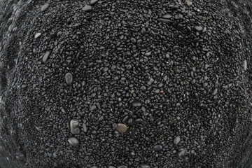 Volcanic rock on black sand beach at Vik in southern Iceland