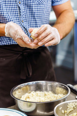 chef making arancini