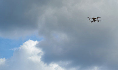 Drone fly on blue sky