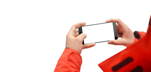Man in red jacket holding phone in horizontal position, isolated on white background