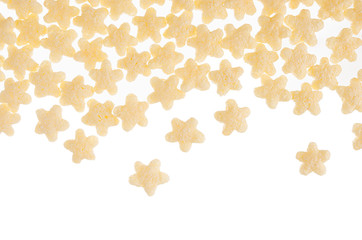 Yellow stars corn flakes isolated on white background with copy space. Cereals texture.
