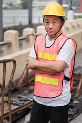 construction worker standing with pile of raw material
