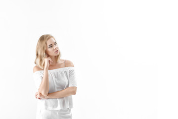 Beautiful blond woman in white blouse and pants on white background. copy spase