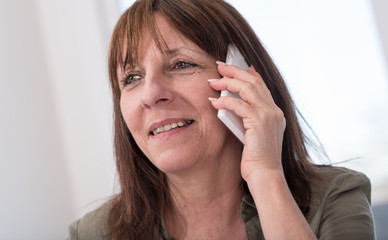 Mature woman calling on mobile phone