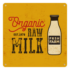 Vintage organic raw milk sign on yellow card, background. Retro classic design.