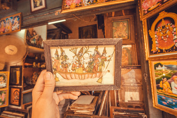 Vintage picture with historical scene and heroes in frame on flea market